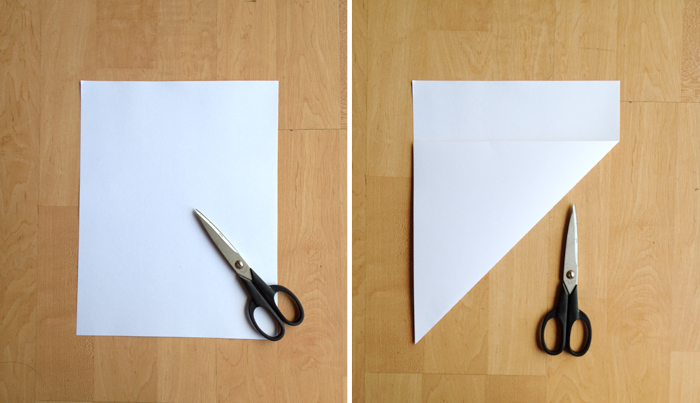 step one of a DIY paper envelope