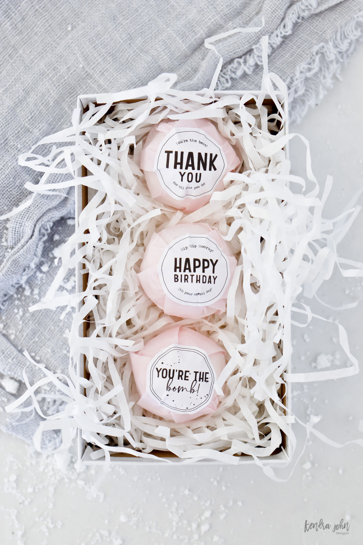 bath bombs in a box with gift tags for thank you, happy birthday, and you're the bomb