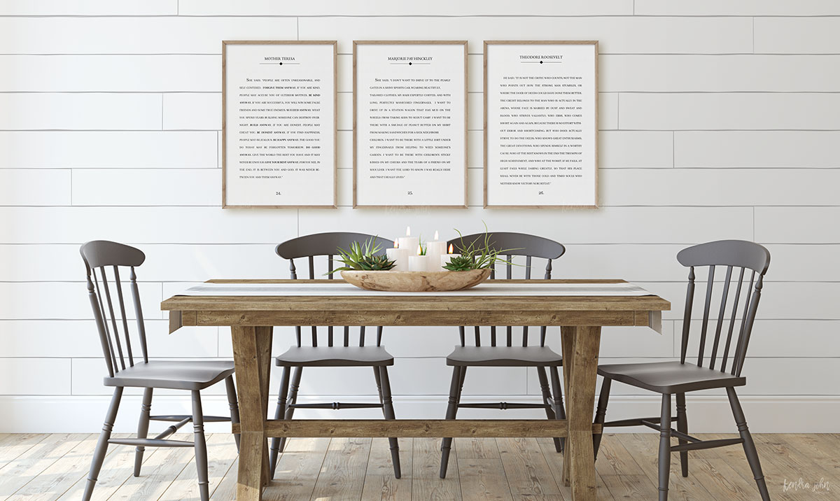 farmhouse style dinning room with large book page prints hanging on shiplap